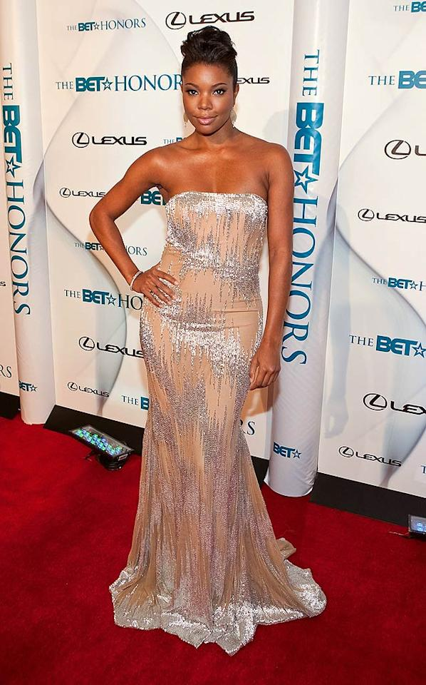 """But Taraji wasn't the only head-turner on hand; Gabrielle Union oozed glamour in a silver-embellished, floor-length gown, which hugged her signature curves in all the right places. Paul Morigi/<a href=""""http://www.wireimage.com"""" target=""""new"""">WireImage.com</a> - January 16, 2010"""