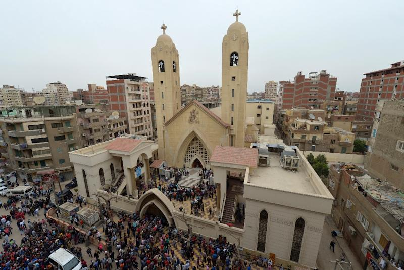 People gather outside the Mar Girgis Coptic Church in Tanta after a bomb blast struck worshippers gathering to celebrate Palm Sunday on April 9, 2017
