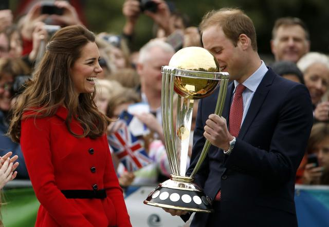 Catherine, the Duchess of Cambridge, laughs as her husband Britain's Prince William holds the Cricket World Cup trophy during a promotional event in Christchurch April 14, 2014. The Prince and his wife Kate are undertaking a 19-day official visit to New Zealand and Australia with their son George REUTERS/Phil Noble (NEW ZEALAND - Tags: ROYALS ENTERTAINMENT POLITICS)
