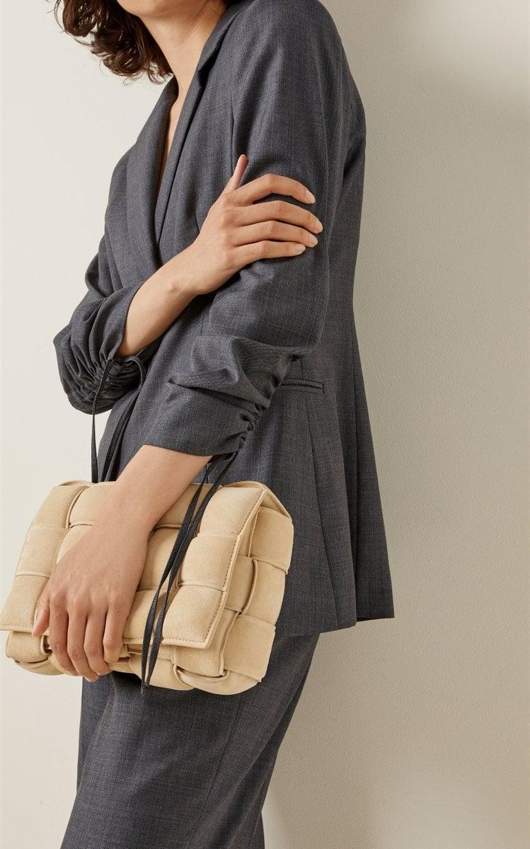 <p>This gray <span>Aya Muse Baojin Ruched Woven Blazer</span> ($835) looks like a classic piece, but it has ruched sleeves, which make the piece unique and standout. We'd wear it over practically everything.</p>