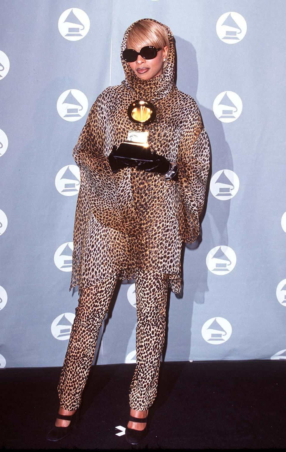<p>Mary J. Blige wore leopard print from head to toe for her 1996 Grammys look. She accessorized in neutral black sunnies, gloves, and shoes to balance her wild ensemble.</p>