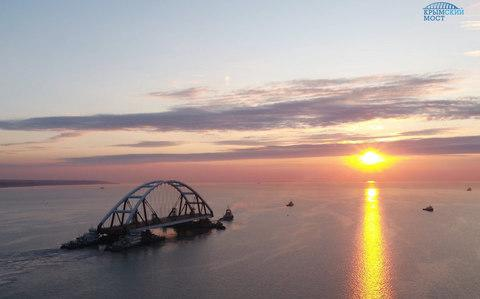 An arch of the Kerch bridge connecting Russia and Crimea is transported to the building site on Tuesday. - Credit: EPA/handout