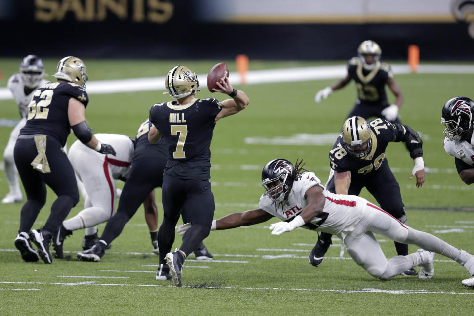New Orleans Saints quarterback Taysom Hill (7) passes under pressure from Atlanta Falcons defensive end Steven Means (55) in the first half of an NFL football game in New Orleans, Sunday, Nov. 22, 2020. (AP Photo/Brett Duke)