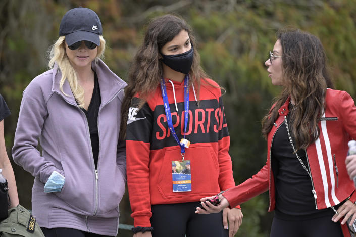 Sam Alexis Woods, center, Elin Nordegren, left, and Erica Herman follow Tiger Woods and Charlie Woods on the 11th hole during the final round of the PNC Championship golf tournament, Sunday, Dec. 20, 2020, in Orlando, Fla. (AP Photo/Phelan M. Ebenhack)