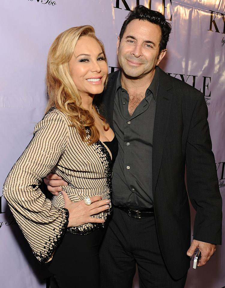 BEVERLY HILLS, CA - JULY 21:  TV personality Adrienne Maloof and husband Paul Nassif attend the pre-opening cocktail party of Kyle Richards' new boutique 'Kyle By Alene Too' on July 21, 2012 in Beverly Hills, California.  (Photo by Angela Weiss/WireImage)