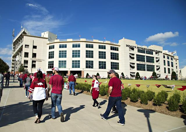 Fans with additional training would be allowed to bring concealed handguns into Razorback Stadium. (Getty)