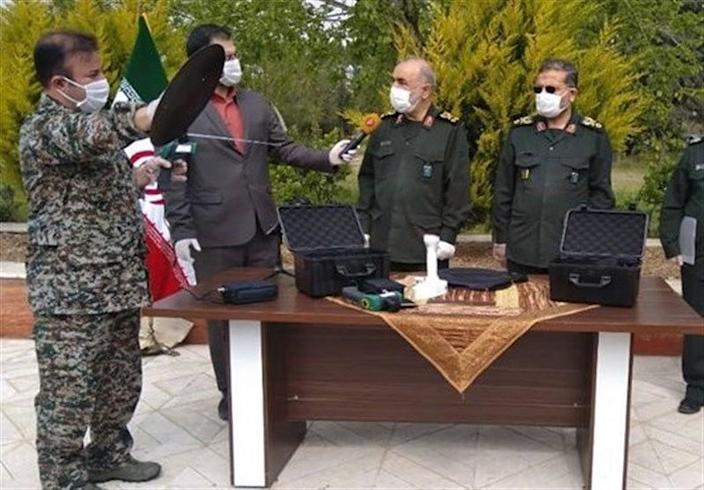 Islamic Revolutionary Guard Corps officers present what they say is a device capable of detecting coronavirus, April 15, 2020. (Iran State TV)