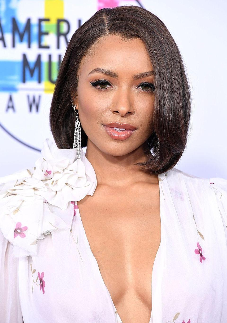 <p>Actress <strong>Kat Graham</strong> has the best of both worlds — one side of her hair is straight with blunt edges and the longer side has an elegant wave. </p>