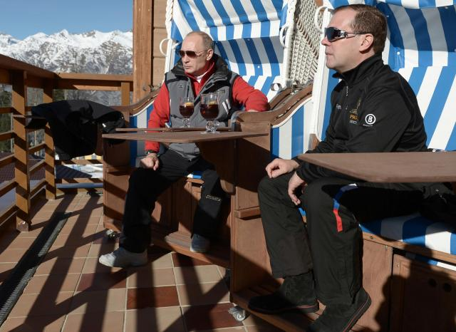 """Russian President Vladimir Putin (L) and Prime Minister Dmitry Medvedev chat during their visit to the """"Laura"""" cross country ski and biathlon centre in the resort of Krasnaya Polyana near Sochi January 3, 2014. REUTERS/Alexei Nikolskiy/RIA Novosti/Kremlin (RUSSIA - Tags: POLITICS SPORT OLYMPICS) ATTENTION EDITORS - THIS IMAGE HAS BEEN SUPPLIED BY A THIRD PARTY. IT IS DISTRIBUTED, EXACTLY AS RECEIVED BY REUTERS, AS A SERVICE TO CLIENTS"""