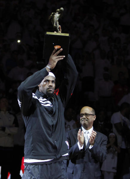 Miami Heat forward LeBron James holds up his NBA MVP trophy before the start of Game 1 in an NBA basketball Eastern Conference semifinal playoff series against the Indiana Pacers, Sunday, April 13, 2012, in Miami. (AP Photo/Wilfredo Lee)