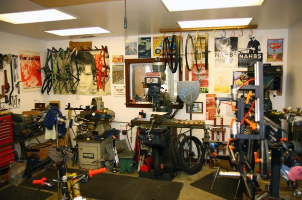 Like most small-batch builders, Curtis Inglis's shop is a condensed mixture of machines, posters, trophies, bike parts, and frames both old and new.