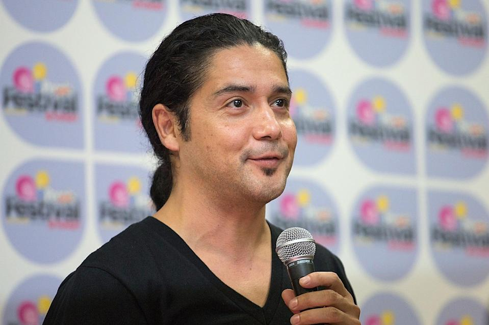 SAN ANTONIO, TX - SEPTEMBER 01:  Musician Chris Pérez of Chris Pérez Project speaks backstage during Festival People en Español Presented by Target at The Alamodome on September 1, 2013 in San Antonio, Texas.  (Photo by Rick Kern/Getty Images)