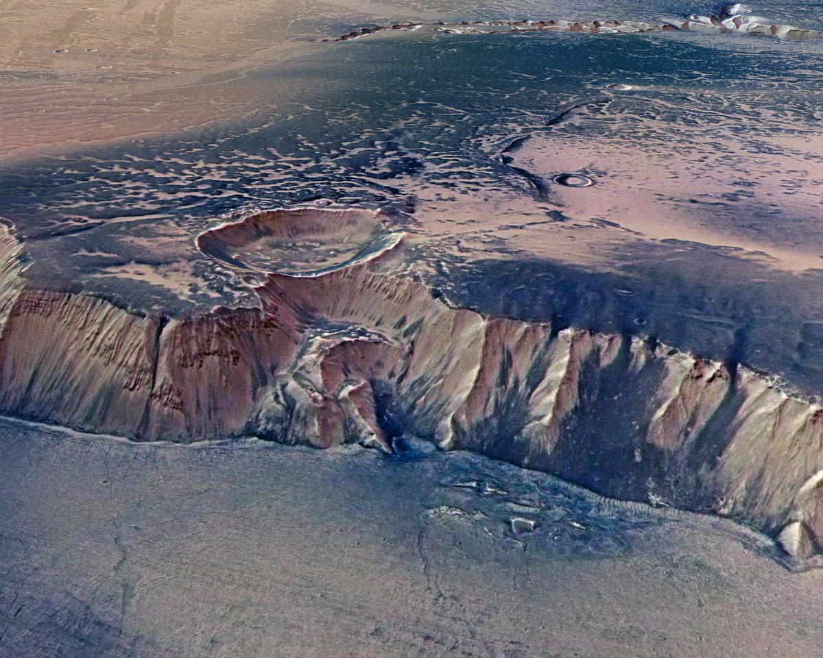 A cliff, up to 4,000 m high, located in the eastern part of Echus Chasma, one of the largest water source regions on Mars, is seen in this image taken by the High-Resolution Stereo Camera (HRSC) on board ESAís Mars Express and made available July 14, 2008. Echus Chasma is the source region of Kasei Valles which extends 3,000 km to the north. The dark regions REUTERS/ESA/DLR/FU Berlin/G.Neukum/Handout.  FOR EDITORIAL USE ONLY. NOT FOR SALE FOR MARKETING OR ADVERTISING CAMPAIGNS.