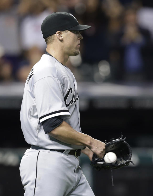 Chicago White Sox relief pitcher Matt Lindstrom reacts after giving up a two-run single to Cleveland Indians' Ryan Raburn in the eighth inning of a baseball game, Tuesday, July 30, 2013, in Cleveland. The Indians won 7-4. (AP Photo/Tony Dejak)
