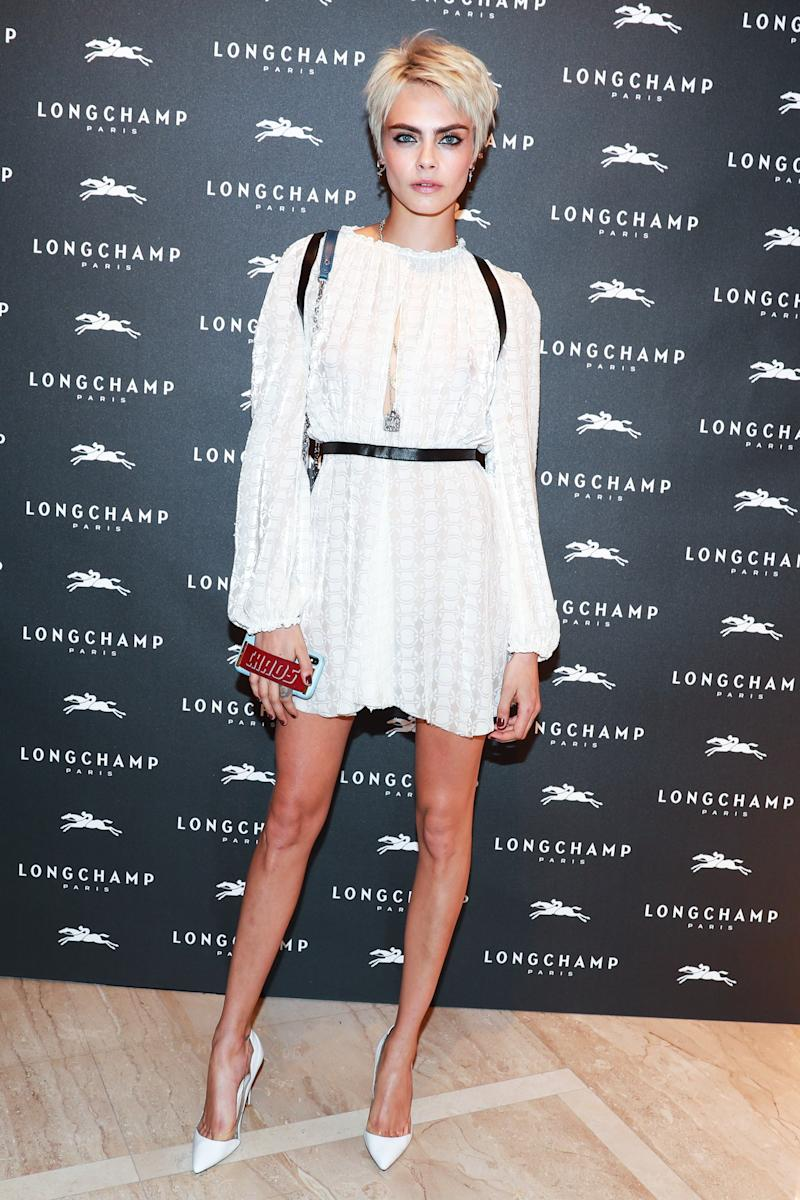 Cara Delevingne attends the opening of Longchamp's Fifth Avenue flagship store.