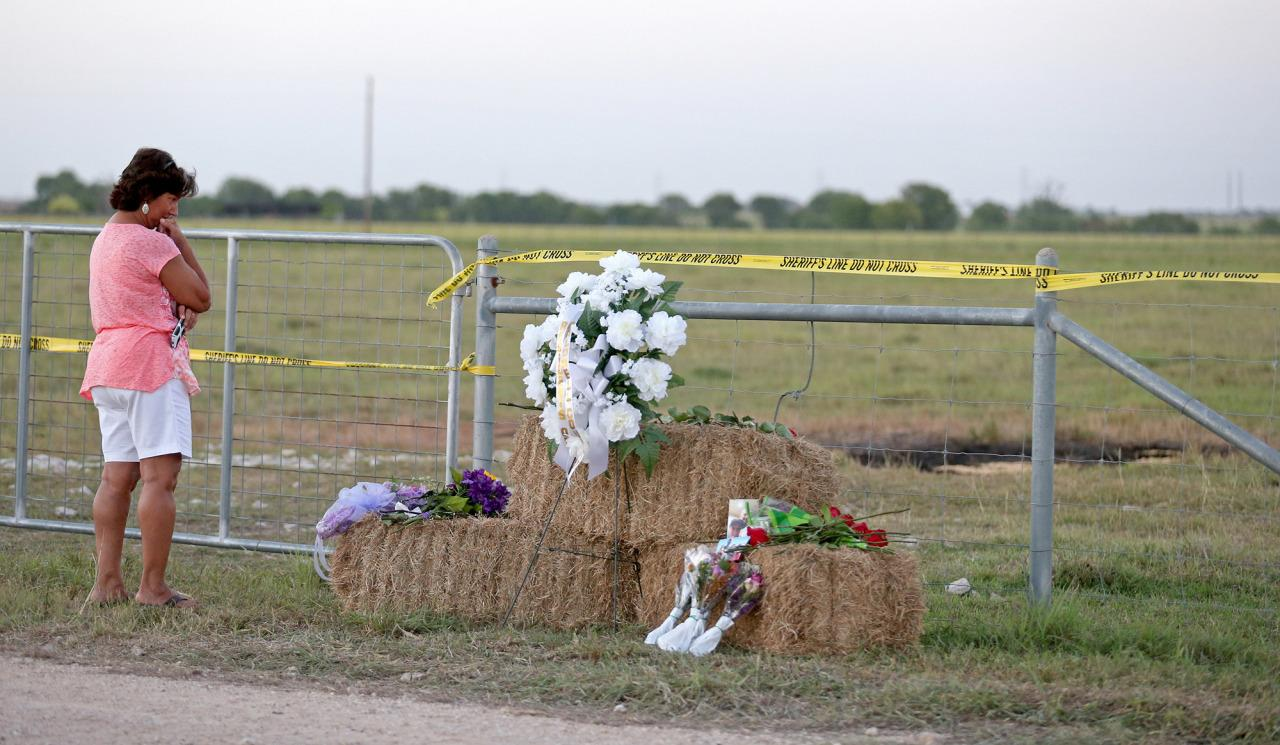 <p>Hot Air Balloon Crash Texas</p><p>Kathy Stephens, of Kyle, Texas, pauses at a memorial, Monday Aug. 1, 2016, at the site of a hot air balloon crash that killed 16 people on Saturday near Lockhart, Texas. (Edward A. Ornelas/San Antonio Express-News via AP)</p>