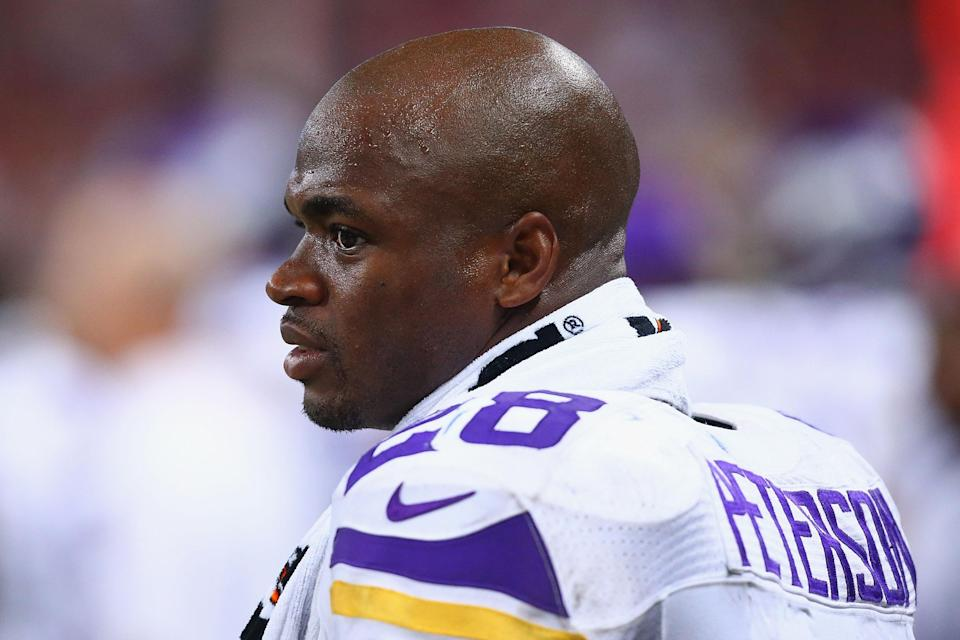Adrian Peterson of the Minnesota Vikings looks on from the sideline during a game against the St. Louis Rams on September 7, 2014 in St. Louis, Missouri (AFP Photo/Dilip Vishwanat)