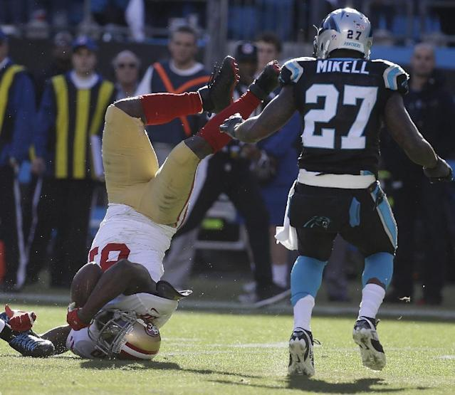 San Francisco 49ers wide receiver Anquan Boldin (81) falls to the turf with a catch against Carolina Panthers strong safety Quintin Mikell (27) during the first half of a divisional playoff NFL football game, Sunday, Jan. 12, 2014, in Charlotte, N.C. (AP Photo/John Bazemore)