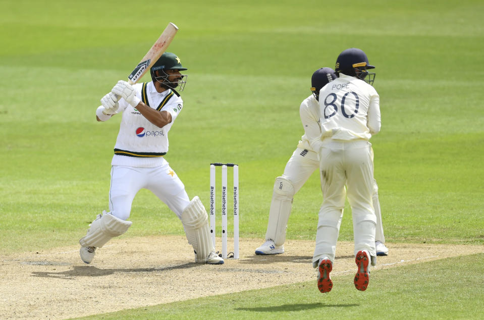 Pakistan's Shan Masood, left, bats during the second day of the first cricket Test match between England and Pakistan at Old Trafford in Manchester, England, Thursday, Aug. 6, 2020. (Dan Mullan/Pool via AP)