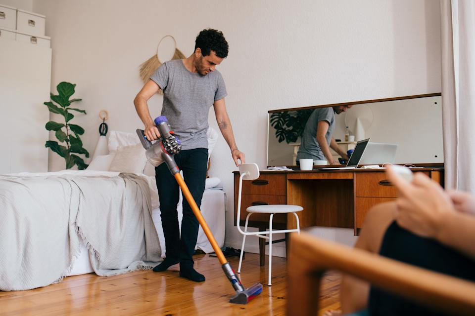 Using a quality vacuum can help reduce the number of allergens in your home. (Photo: Maskot via Getty Images)