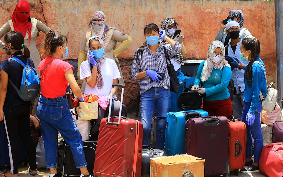 Migrants from North-east stand await special trains and buses in Jaipur, India to return home amid the coronavirus lockdown. Source: Getty