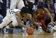 Butler's Khalif Battle, left, and Louisiana Monroe's Josh Nicholas, right, battle for a loose ball during the first half of an NCAA college basketball game, Saturday, Dec. 28, 2019, in Indianapolis. (AP Photo/Darron Cummings)