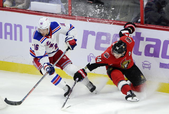 New York Rangers center Ryan Strome (16) keeps the puck from Ottawa Senators defenseman Mark Borowiecki (74) during the third period of an NHL hockey game Friday, Nov. 22, 2019, in Ottawa, Ontario. (Sean Kilpatrick/The Canadian Press via AP)