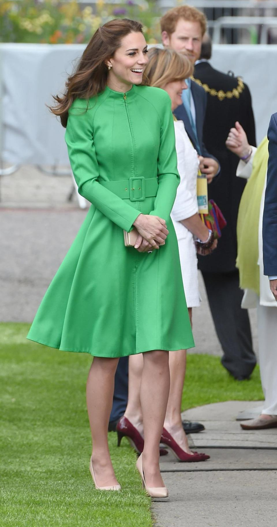 <p>Opting for a brighter look, the Duchess wore a green Catherine Walker coat dress to the Chelsea Flower Show. L.K. Bennett's nude clutch and pumps accessorised the outfit. <br></p><p><i>[Photo: PA]</i></p>