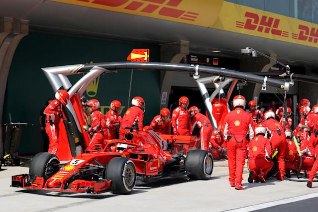 Formula One - F1 - Chinese Grand Prix - Shanghai, China - April 15, 2018 - Ferrari driver Sebastian Vettel of Germany sits in his car at a pit-stop during the race. Pool via REUTERS