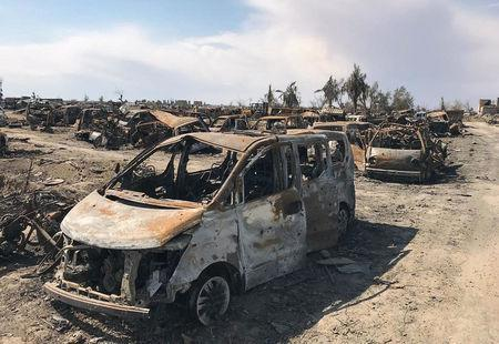 A view of burnt vehicles after the U.S.-backed forces said they had captured Islamic State's last shred of territory, in the village of Baghouz, Deir Al Zor province, Syria, March 23, 2019. REUTERS/Stringer
