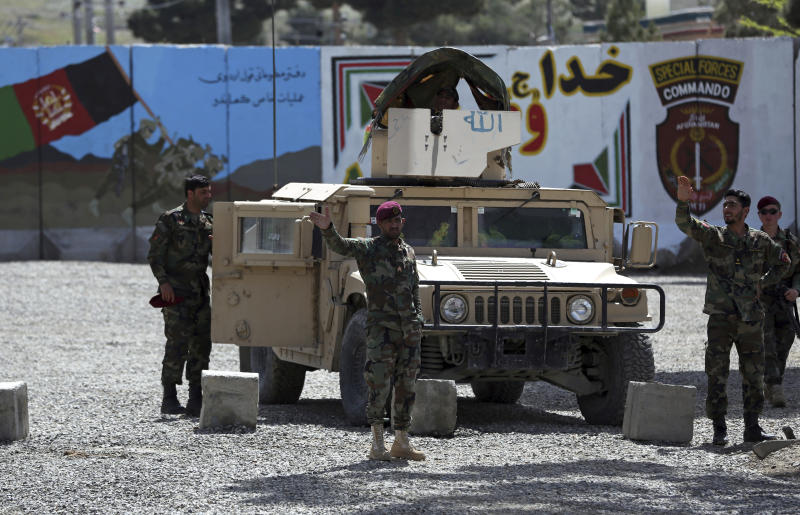 Afghan special forces stand guard near the site of a suicide bomber attack on the outskirts of Kabul, Afghanistan, Wednesday, April 29, 2020. A suicide bomber on Wednesday targeted a base belonging to Afghan special forces on the southern outskirts of the capital, Kabul, officials said. (AP Photo/Rahmat Gul)