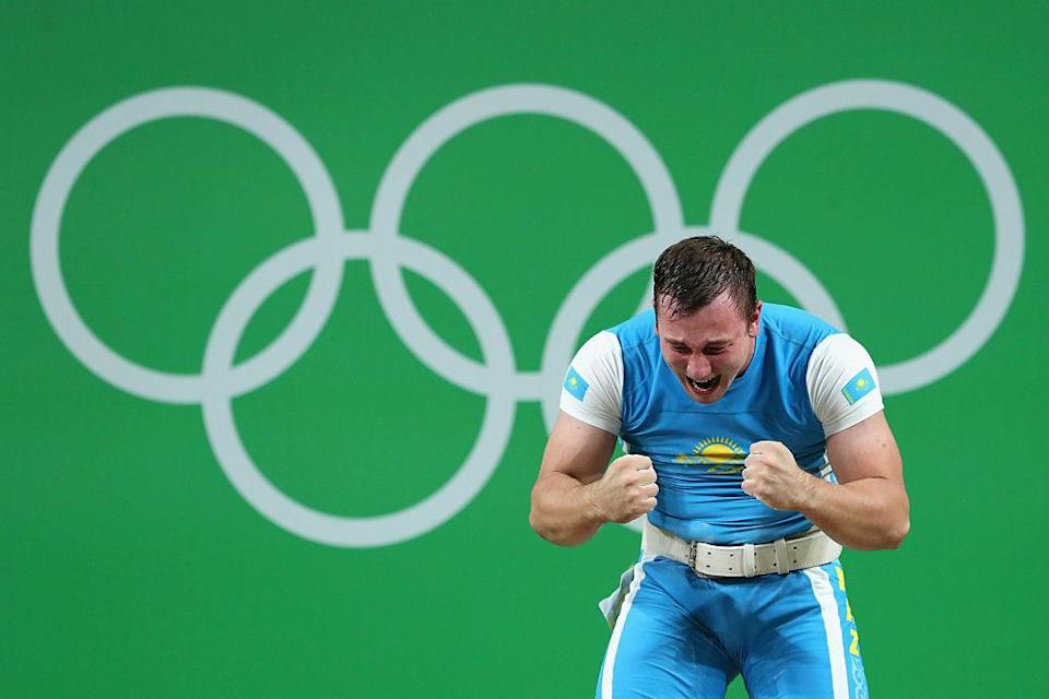 A weightlifter from Kazakhstan reacts during the men's 105kg competition at the Olympics. (Getty)