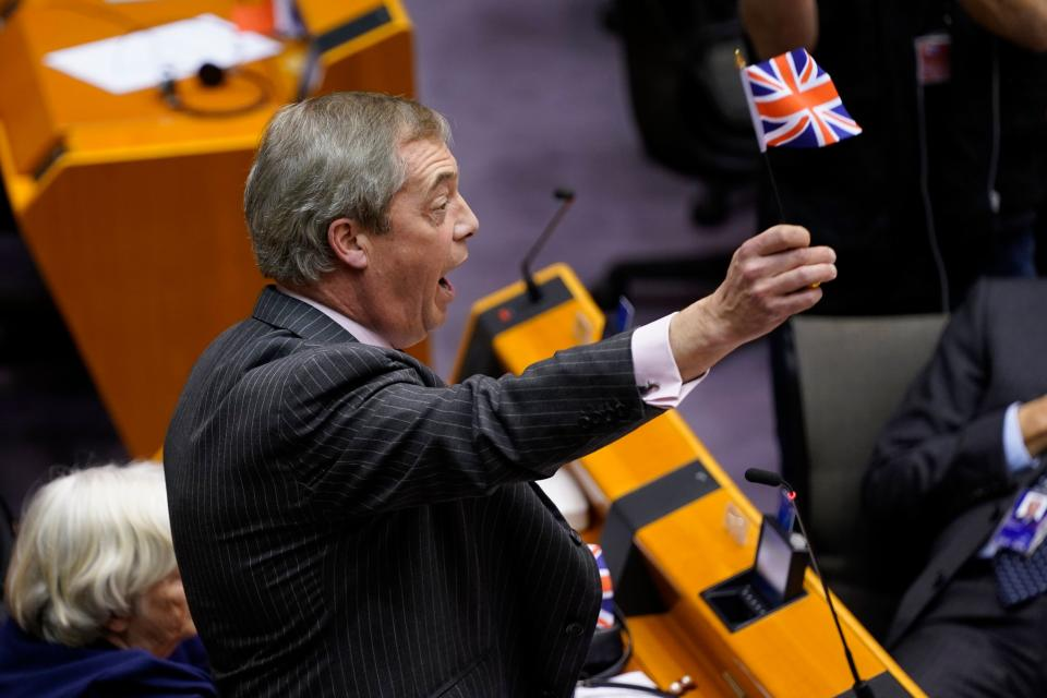 Britain's Brexit Party leader Nigel Farage (C)  waves a union flag  during a European Parliament plenary session in Brussels on January 29, 2020, as Brexit Day is to be set in stone when the European Parliament casts a vote ratifying the terms of Britain's divorce deal from the EU. (Photo by Kenzo TRIBOUILLARD / AFP) (Photo by KENZO TRIBOUILLARD/AFP via Getty Images)