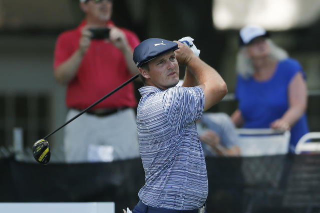 Bryson DeChambeau drives on the 12th tee during the third round of the Rocket Mortgage Classic golf tournament, Saturday, July 4, 2020, at the Detroit Golf Club in Detroit. (AP Photo/Carlos Osorio)