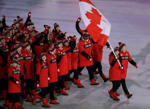 The choice of Tessa Virtue and Scott Moir to carry the Canadian flag at the opening ceremony of the 2018 Pyeongchang Olympics demonstrates not only the importance of figure skating in the country, but also the gender equality in the sport. (Associated Press - image credit)