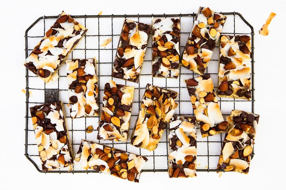 """Whether you call them magic bars or seven-layer cookies, you probably know these treats. Chunky bits—like chocolate chips, nuts, and coconut—get layered over sticky condensed milk and a crisp cookie crust. <a href=""""https://www.epicurious.com/recipes/food/views/potato-chip-crusted-magic-bars-recipe?mbid=synd_yahoo_rss"""" rel=""""nofollow noopener"""" target=""""_blank"""" data-ylk=""""slk:See recipe."""" class=""""link rapid-noclick-resp"""">See recipe.</a>"""