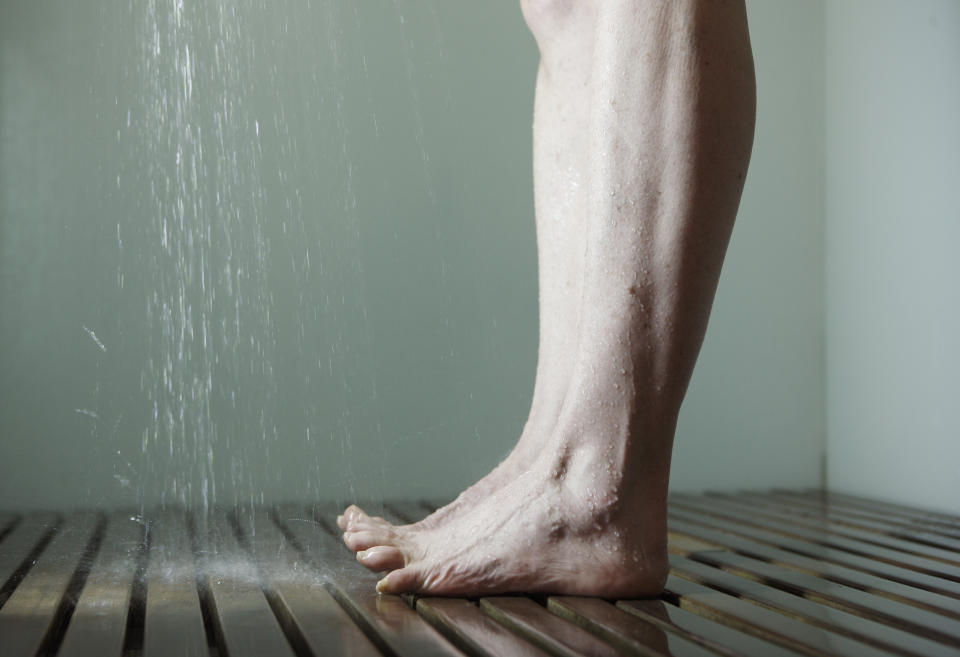 Woman's legs in the shower.(PHOTO: Getty Images)