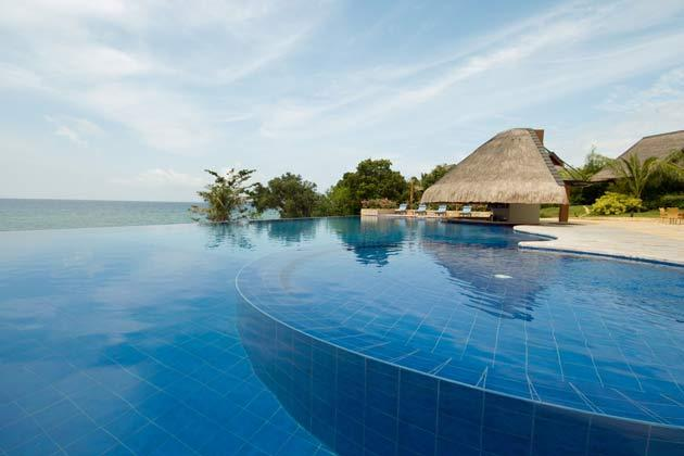 """<strong>3. Eskaya Beach Resort & Spa, Panglao Island, Bohol: Royal Meets Rustic</strong> <br /><br />Located on the southernmost tip of Bohol, nicknamed the """"quieter Boracay"""" (uncommercialized beaches and a friendly—not frenzied—vibe), Eskaya is an all-villa luxury resort featuring distinctly Filipino architecture, and is listed among the Small Luxury Hotels of The World."""