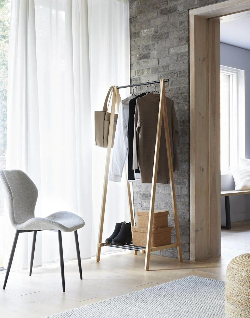 <p>Sustainable products are at the heart of Dunelm's new range, including this gorgeous clothes rail (£65) which has been made from ethically sourced wood. </p>