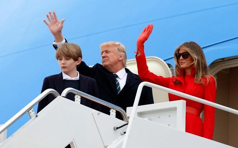 U.S. President Donald Trump boards Air Force One with his wife Melania and son Barron as they depart Joint Base Andrews in Maryland, U.S - Reuters