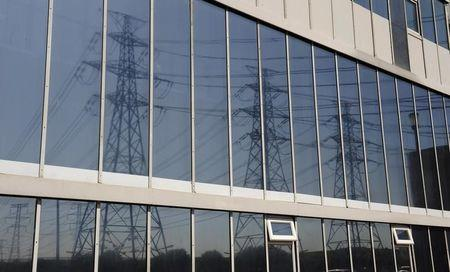 Power lines are reflected in windows at the Rio Tinto power station in Lynemouth
