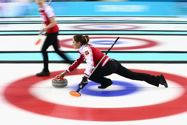 SOCHI, RUSSIA - FEBRUARY 10: Anna Sidorova of Russia in action during the round robin match against Denmark during day 3 of the Sochi 2014 Winter Olympics at Ice Cube Curling Center on February 10, 2014 in Sochi, Russia. (Photo by Clive Mason/Getty Images)