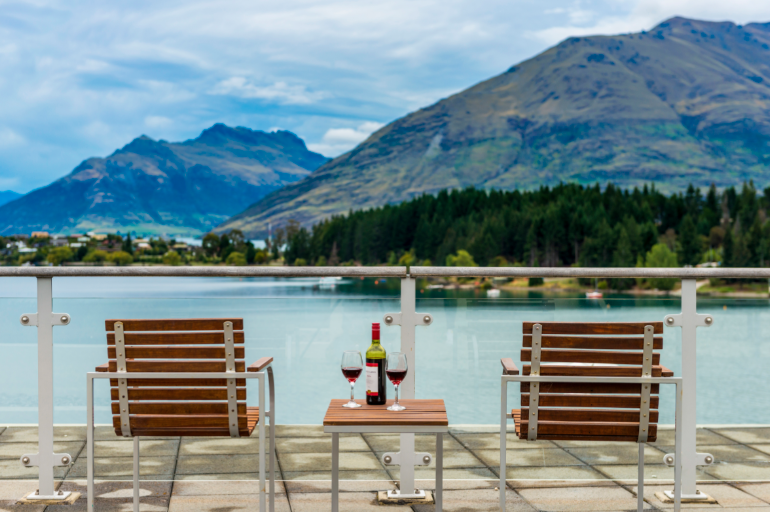 two chairs overlooking a lake in queenstown new zealand
