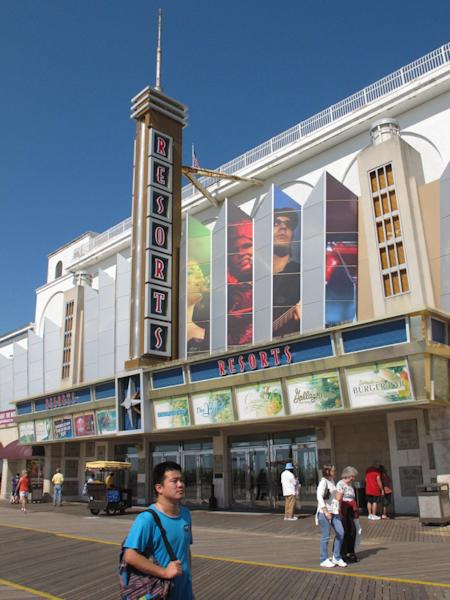 In a Sept. 14, 2012 photo pedestrians pass a casino on the Atlantic City, N.J. Boardwalk. A poll released Sept. 24, 2012 finds most New Jerseyans oppose expanding casino gambling outside of Atlantic City, and also oppose state tax breaks for casino companies. (AP Photo/Wayne Parry)