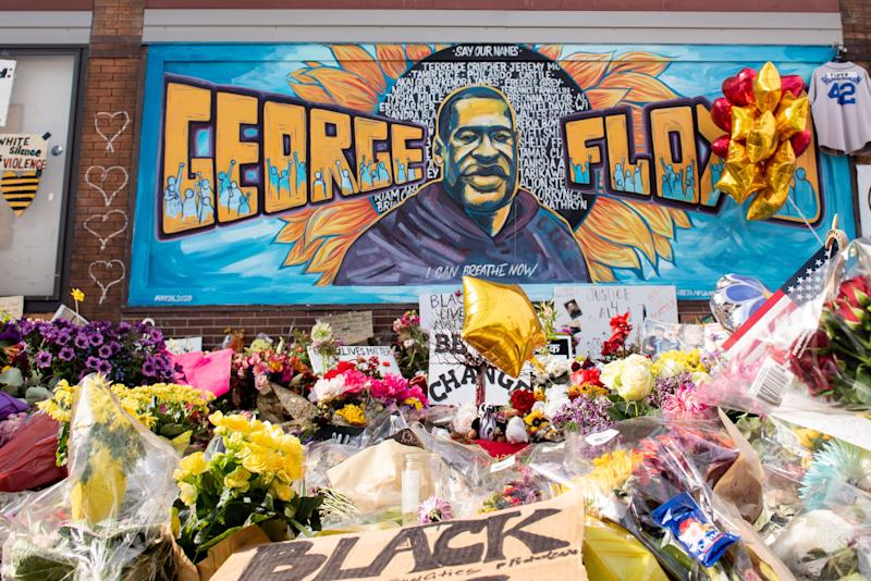 Community members gather in Minneapolis, where George Floyd was killed. The intersection served as a memorial and sacred space to honor Floyd.