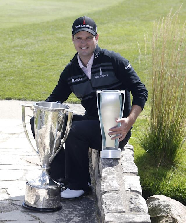 Zach Johnson poses with the Western Golf Association trophy, left, and the BMW Championship trophy after winning the BMW Championship golf tournament at Conway Farms Golf Club in Lake Forest, Ill., Monday, Sept. 16, 2013. (AP Photo/Charles Rex Arbogast)
