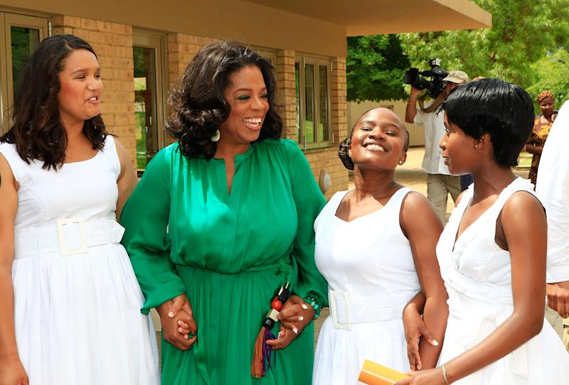 MEYERTON, HENLEY ON KLIP - JANUARY 14:  Oprah Winfrey poses with the Graduates at the inaugural graduation of the class of 2011 at Oprah Winfrey Leadership Academy for Girls on January 14, 2012 in Henley on Klip, South Africa.  (Photo by Michelly Rall/Getty Images)