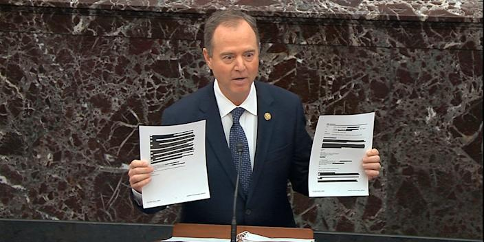 In this image from video, House impeachment manager Rep. Adam Schiff, D-Calif., holds redacted documents as he speaks during the impeachment trial against President Donald Trump in the Senate at the U.S. Capitol in Washington, Wednesday, Jan. 22, 2020. (Senate Television via AP)