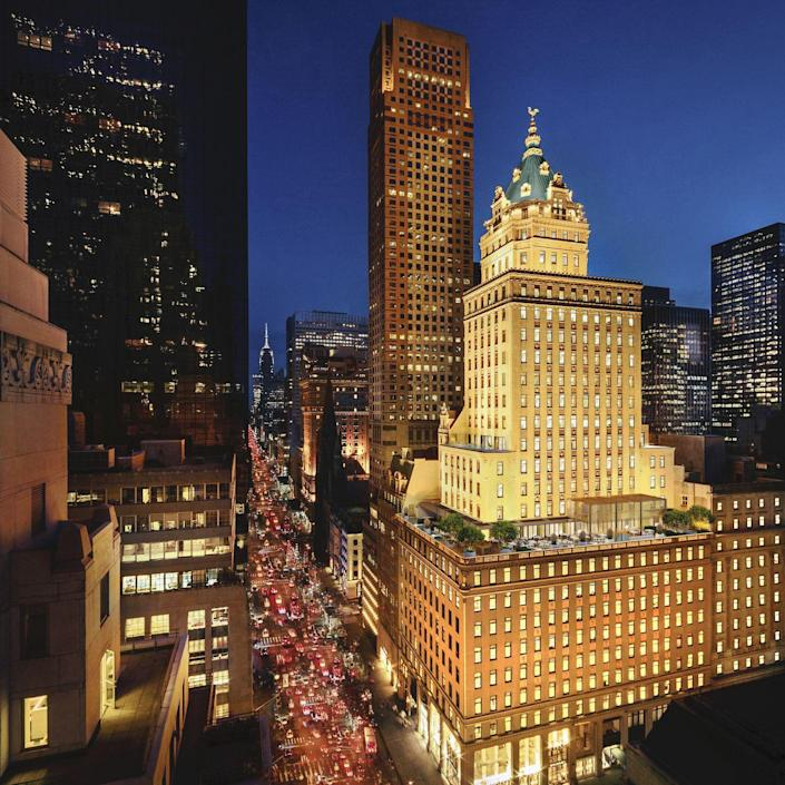 """<p><a href=""""https://www.aman.com/resorts/aman-new-york"""" rel=""""nofollow noopener"""" target=""""_blank"""" data-ylk=""""slk:Aman New York"""" class=""""link rapid-noclick-resp"""">Aman New York</a> resides in the artfully restored Crown Building at the corner of Fifth Avenue and West 57th Street and honors the city's Gilded Age. With 26 floors of accommodations offering skyline and Central Park views, this property will offer urban luxury at its finest with a three-story spa, subterranean jazz club, cigar lounge, French wine library, among other fantastic amenities. Aman New York will make you believe that New York's Golden Age is happening in the here and now.</p><p><em>Aman New York is expected to open in 2021. Nightly rates have yet to be determined.</em></p>"""