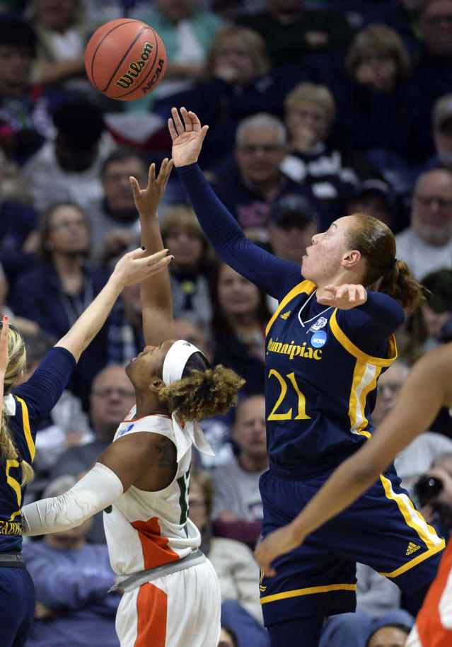 Quinnipiac's Jen Fay (21) battles for a rebound against Miami's Lauren Dickerson (13) during the second half of a first-round game in the NCAA women's college basketball tournament in Storrs, Conn. Saturday, March 17, 2018. Quinnipiac won, 86-72. (AP Photo/Stephen Dunn)
